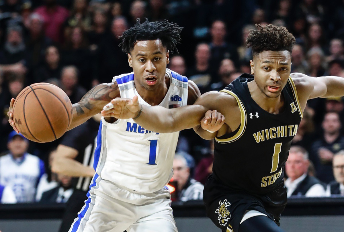 <strong>Memphis guard Tyler Harris (left) is called for a offensive foul while driving to the basket against Wichita State defender Tyson Etienne (right) Jan. 9, 2020, in Wichita, Kansas.</strong> (Mark Weber/Daily Memphian)