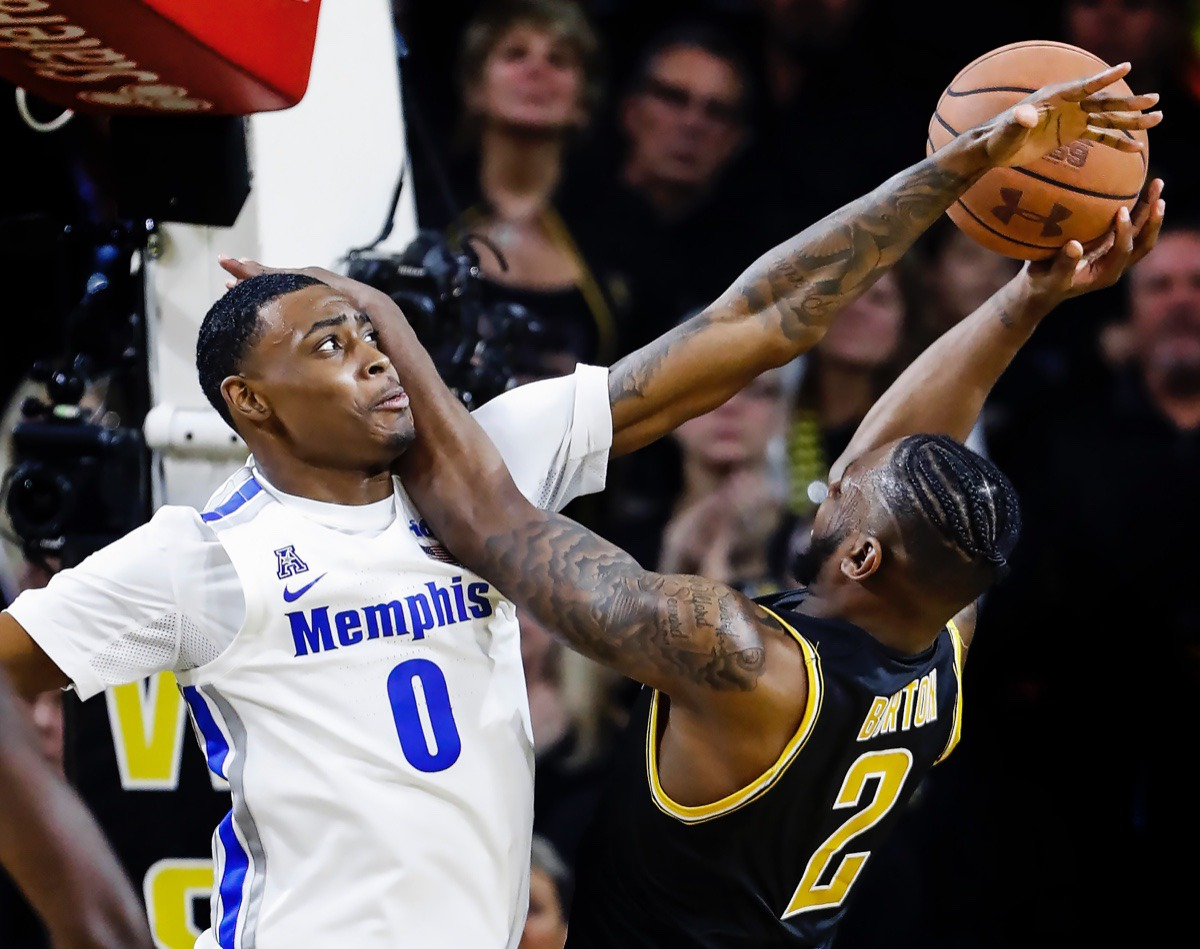 <strong>Memphis defender DJ Jeffries (left) fouls Wichita State guard Jamarius Burton (right) during action Jan. 9, 2020, in Wichita, Kansas.</strong> (Mark Weber/Daily Memphian)
