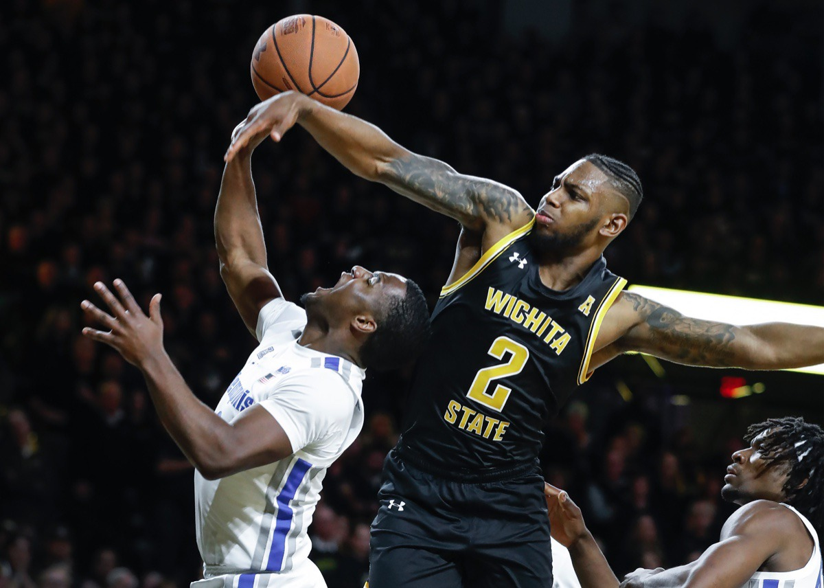 <strong>Memphis guard Alex Lomax (left) is fouled by Wichita State defender Jamarius Burton (right) while driving the lane Jan. 9, 2020, in Wichita, Kansas</strong>. (Mark Weber/Daily Memphian)