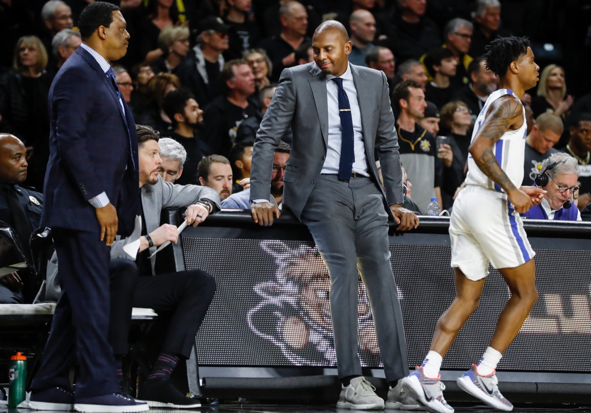 <strong>Memphis head coach Penny Hardaway (middle) sits on the scores table during the final minutes of a 76-67 loss to Wichita State Jan. 9, 2020, in Wichita, Kansas.</strong> (Mark Weber/Daily Memphian)