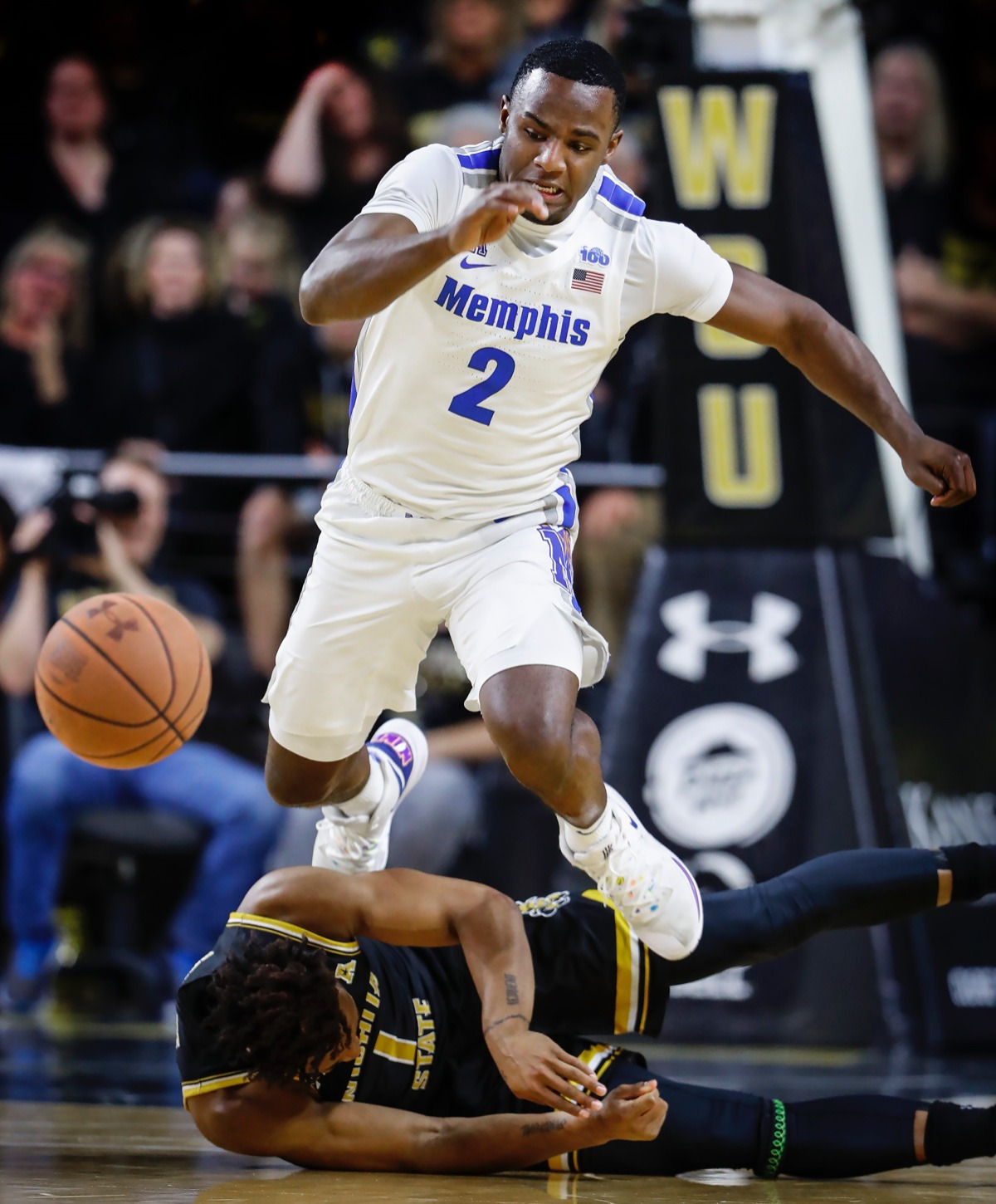 <strong>Memphis defender Alex Lomax (top) leaps over Wichita State guard Tyson Etienne (bottom) while scrambling for a loose ball Jan. 9, 2020, in Wichita, Kansas.</strong> (Mark Weber/Daily Memphian)