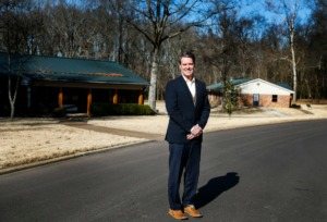 <strong>Youth Villages CEO Pat Lawler stands among several of the first buildings erected on the original Dogwood Village campus on Wednesday, Jan. 8, in Arlington. Lawler recently celebrated his 40th anniversary running the organization that provides services to troubled children and their families.</strong> (Mark Weber/Daily Memphian)