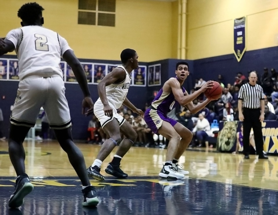 <strong>Christian Brothers High School senior guard Reese McMullen (11) looks for an open teammate while surrounded by Whitehaven High School players during a 64-62 loss in a Jan. 10, 2020, tournament held at Lausanne Collegiate School.</strong> (Patrick Lantrip/Daily Memphian)
