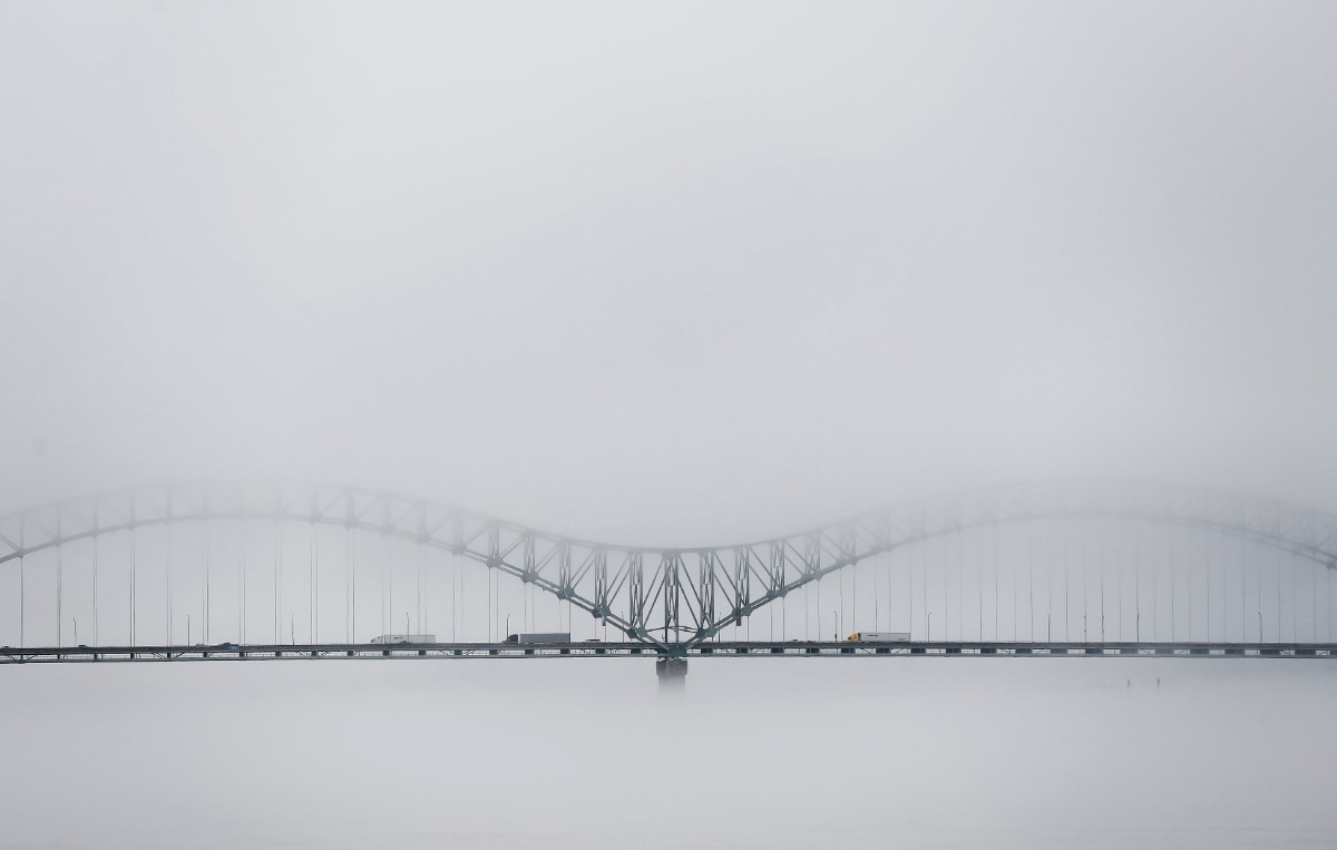 <strong>A dense fog engulfs the I-40 bridge as traffic makes its way to Arkansas Saturday, Jan. 11, 2020.</strong> (Mark Weber/Daily Memphian)
