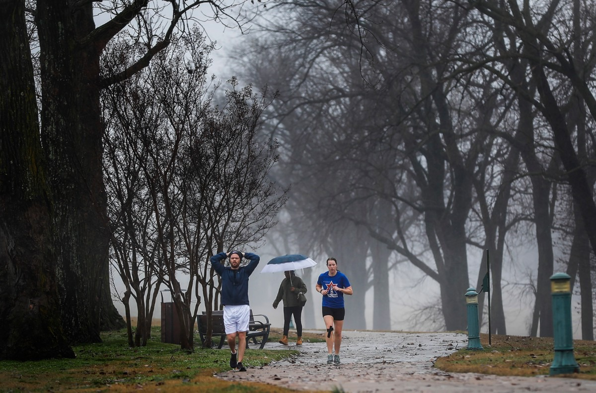 <strong>Runners make their way through heavy fog in Greenbelt Park on Saturday, Jan. 11, 2020 on Mud Island.</strong> (Mark Weber/Daily Memphian)