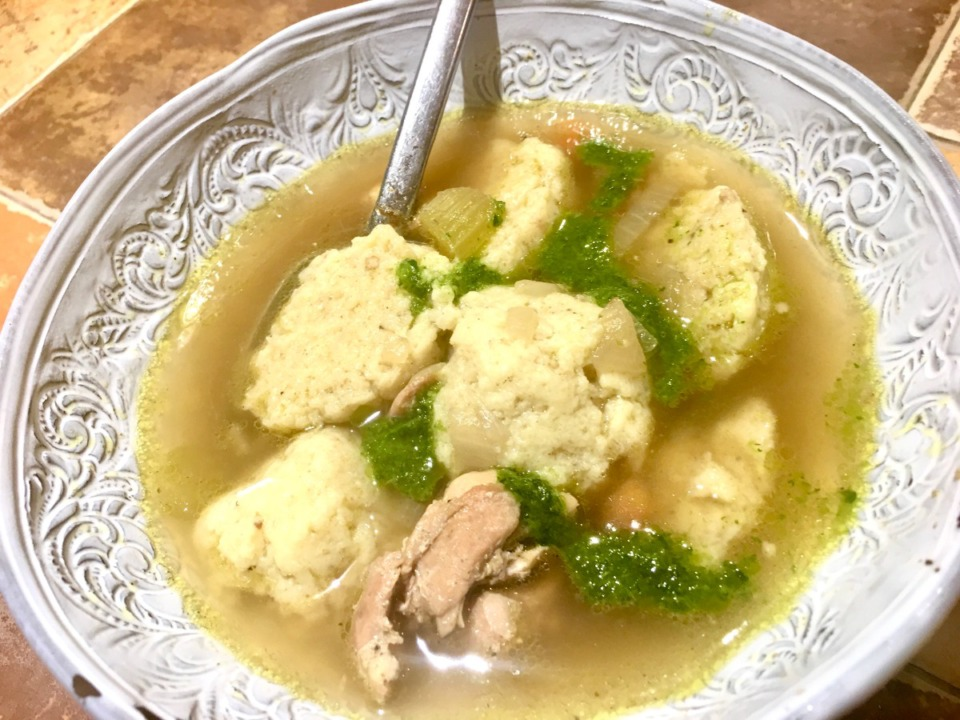 <strong>Matzo ball soup is brightened up with a drizzle of persillade, a quick sauce made with parsley, lemon and garlic.</strong> (Jennifer Biggs: Daily Memphian)