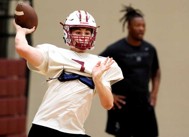 <strong>St. George's quarterback Spencer Smith runs passing drills during practice on Wednesday, Nov. 7. The Gryphons are the only sub-.500 team from Shelby County still in the playoffs.</strong> (Houston Cofield/Daily Memphian)