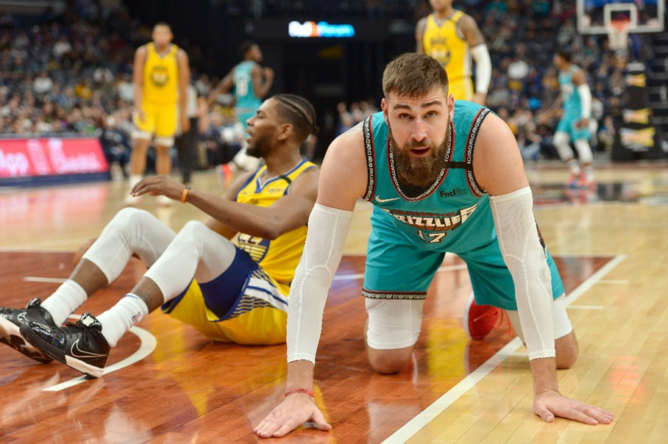 <strong>Memphis Grizzlies center Jonas Valanciunas (17) kneels on the court after forcing a jump ball against Golden State Warriors forward Glenn Robinson III (22) in the second half of an NBA basketball game Sunday, Jan. 12, 2020, in Memphis, Tenn.</strong> (AP Photo/Brandon Dill)