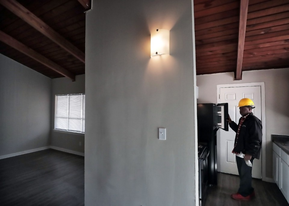 <strong>Shanta Hardaway checks the appliances in a renovated second floor apartment in the Hunter's Ridge complex in Raleigh on Jan. 8, 2019. The renovation of Hunters Ridge is part of a larger $24 million project in the Raleigh/Frayser area by New Jersey Based developer Charles Florio to improve over 500 units.</strong> (Jim Weber/Daily Memphian)