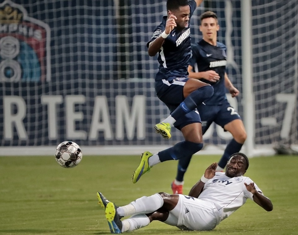 <strong>Memphis midfielder Marcus Epps avoids a collision with the Rangers' Mark Segbers on a sliding steal during 901FC's 4-2 win over Swope Park at AutoZone Park on Sept. 7, 2019.</strong> (Jim Weber/Daily Memphian file)