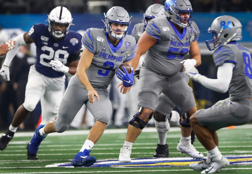 <strong>Memphis quarterback Brady White (middle) looks for a lane against the Penn State defense during action at the Cotton Bowl on Dec. 28, 2019, at AT&amp;T Stadium in Arlington, Texas.</strong> (Mark Weber/Daily Memphian)