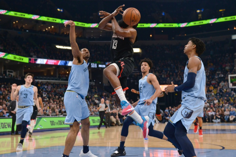 <strong>Memphis Grizzlies guard De'Anthony Melton, center left, knocks the ball away from Houston Rockets guard James Harden (13) as Memphis forward Brandon Clarke (15) and guard Ja Morant (12) move for position during the first half of an NBA basketball game Tuesday, Jan. 14, 2020, at FedExForum.</strong> (Brandon Dill/AP)