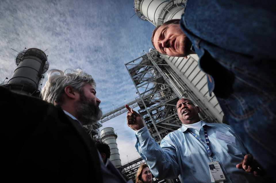 <strong>TVA analyst Oscar Echols (center) talks to Scott Wright (left) and Matthew Peterson about the cooling towers while conducting a tour of the new Allen Combined Cycle Plant in southwest Memphis on Nov. 8  after a formal opening ceremony for the natural gas power plant.</strong> (Jim Weber/Daily Memphian)