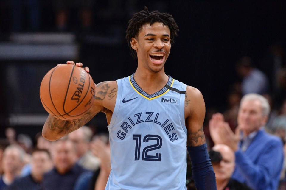 <strong>Memphis guard Ja Morant holds the ball while the Grizzlies run out the clock in an NBA basketball game against the Houston Rockets on Tuesday, Jan. 14, 2020, at FedExForum.</strong> (Brandon Dill/AP)