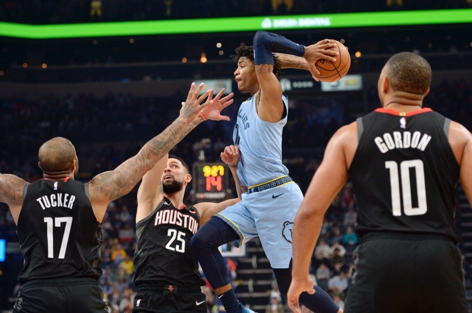 <strong>Memphis Grizzlies guard Ja Morant looks to pass the ball over Houston Rockets forward PJ Tucker (17) and guard Austin Rivers (25) Tuesday, Jan. 14, 2020, at FedExForum.</strong> (Brandon Dill/AP)