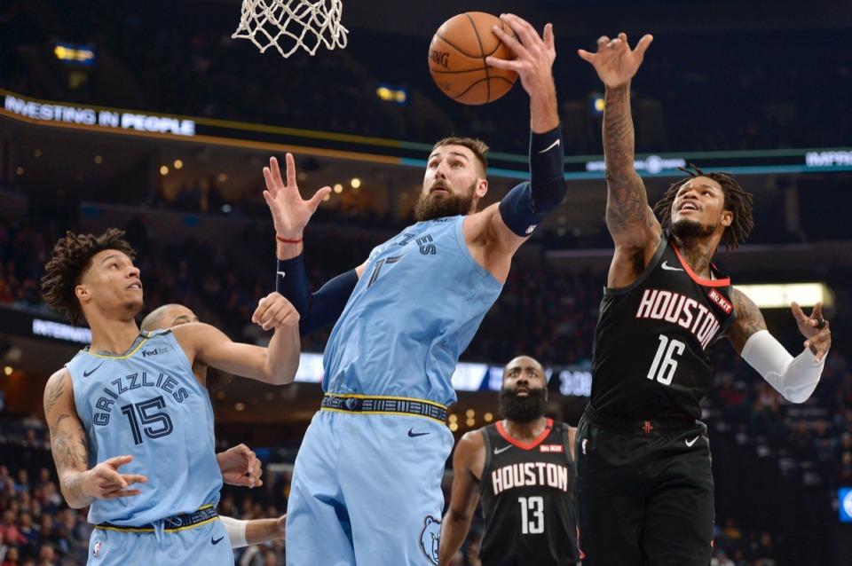 <strong>Memphis Grizzlies center Jonas Valanciunas (17) grabs the ball between forward Brandon Clarke (15) and Houston Rockets guards Ben McLemore (16) and James Harden (13) Tuesday, Jan. 14, 2020, at FedExForum.</strong> (Brandon Dill/AP)