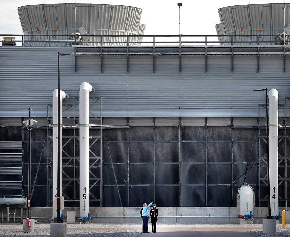 <strong>Mark Whitten (left) with TVA conducts a tour of the new Allen Combined Cycle Natural Gas Plant in southwest Memphis for Tori Lester on Nov. 8 after a formal opening ceremony for the natural gas power plant.</strong> (Jim Weber/Daily Memphian)