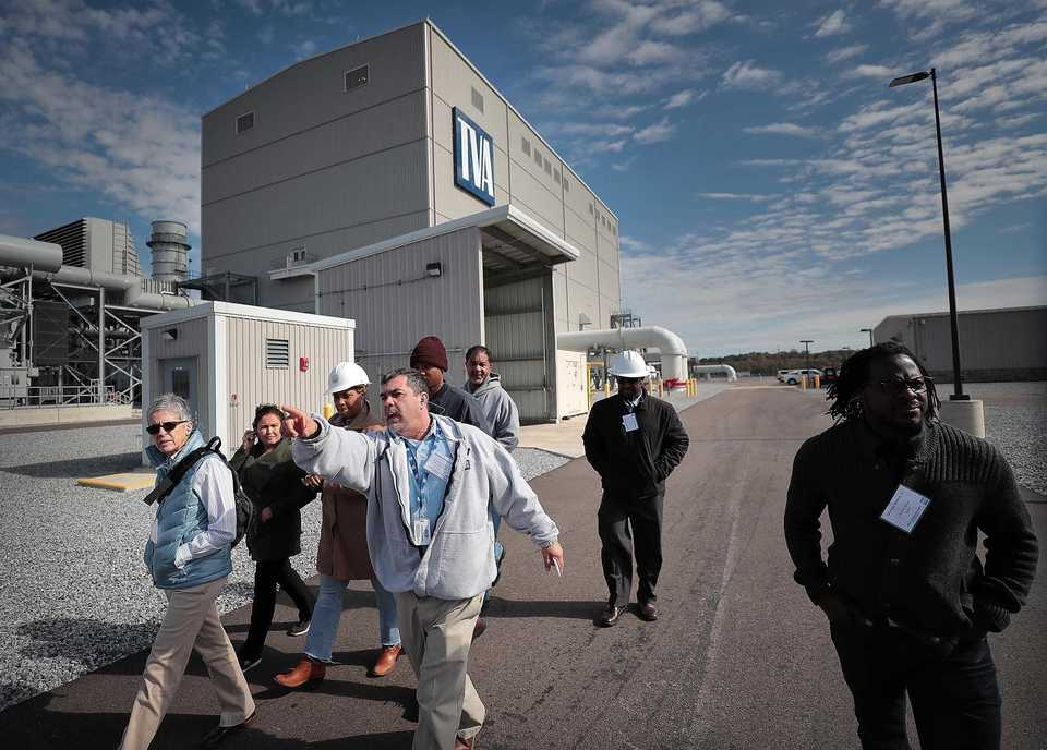 <strong>TVA maintenance coordinator George Czeiszperger (center) leads a tour of the new Allen Combined Cycle Natural Gas Plant in southwest Memphis for a group of MLGW employees on Nov. 8 after a formal opening ceremony for the natural gas power plant.</strong> (Jim Weber/Daily Memphian)