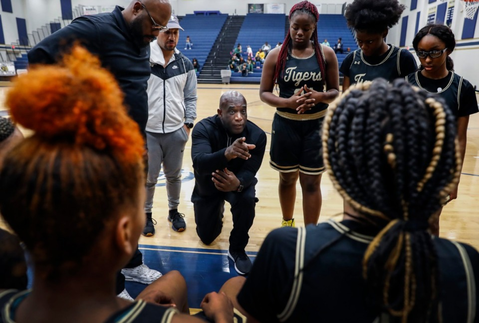 <strong>Whitehaven head coach Lynn Smith (middle) directs his players during a break in action against Memphis Business Academy on Jan. 2, at Arlington High School. Whitehaven won the game 67-30, a score that illustrates the skill gap between the two schools. But Whitehaven's 110-2 rout of Kingsbury on Tuesday, Jan. 14,&nbsp;displayed an even more lopsided matchup. And, neither team wins in the end.&nbsp;</strong>(Mark Weber/Daily Memphian)