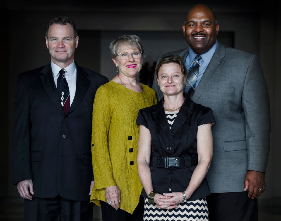 <strong>Richard J. Myers (left) is leading a group of parents raising money for a $6 million STEM facility at Whitehaven High School. Shown with him are Margaret Barr Myers (second from left), Corrie Metcalf and Vincent J. McCaskill, president and CEO of SchoolSeed.</strong> (Mark Weber/Daily Memphian)