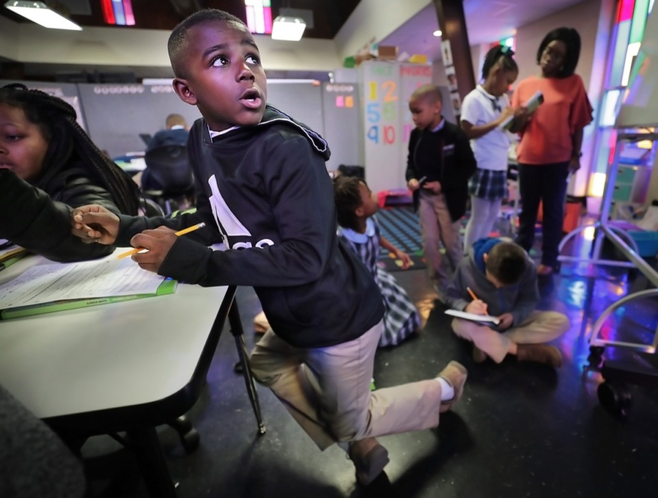 <strong>Memphis STEM Academy third-grader Calub Abraham consults the board while working on math classwork Jan. 16, 2020. The academy will be moving to a new location in Harmony Plaza in Frayser in the fall.</strong> (Jim Weber/Daily Memphian)