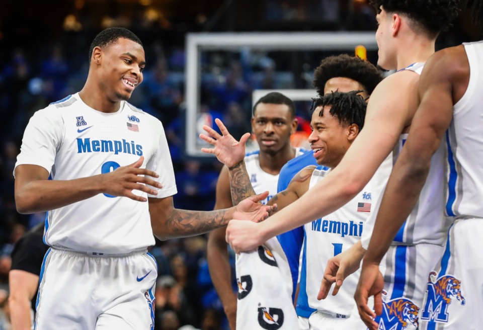 <strong>Memphis forward DJ Jeffries (left) celebrates with his teammates during a break against Cincinnati Thursday, Jan. 16, 2020, at FedExForum.</strong> (Mark Weber/Daily Memphian)