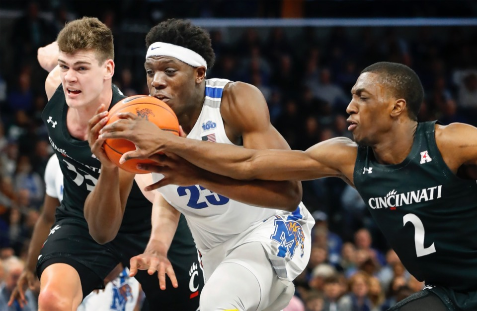 <strong>Memphis forward Malcolm Dandridge (middle) is fouled while driving the lane against Cincinnati defenders Chris Vogt (left) and Keith Williams (right) Thursday, Jan. 16, 2020, at FedExForum.</strong> (Mark Weber/Daily Memphian)
