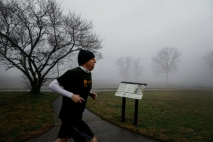 <strong>A runner passes a Trail of Tears historical marker in Mud Island's Greenbelt Park on Wednesday, Jan. 15. The marker, dedicated in November, tells the story of how Cherokee people were moved from their homelands after the passing of the Indian Removal Act.</strong> (Mark Weber/Daily Memphian)