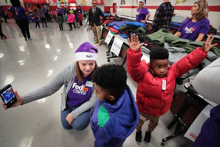 <strong>Students try on their new coats during a giveaway Thursday, Nov. 8, at Hawkins Mill Elementary School. Memphis-based FedEx is providing money and volunteers for coat giveaways at a dozen other locations around the U.S. and Canada. Operation Warm is pushing toward distributing its 3 millionth coat.</strong> (Jim Weber/Daily Memphian)