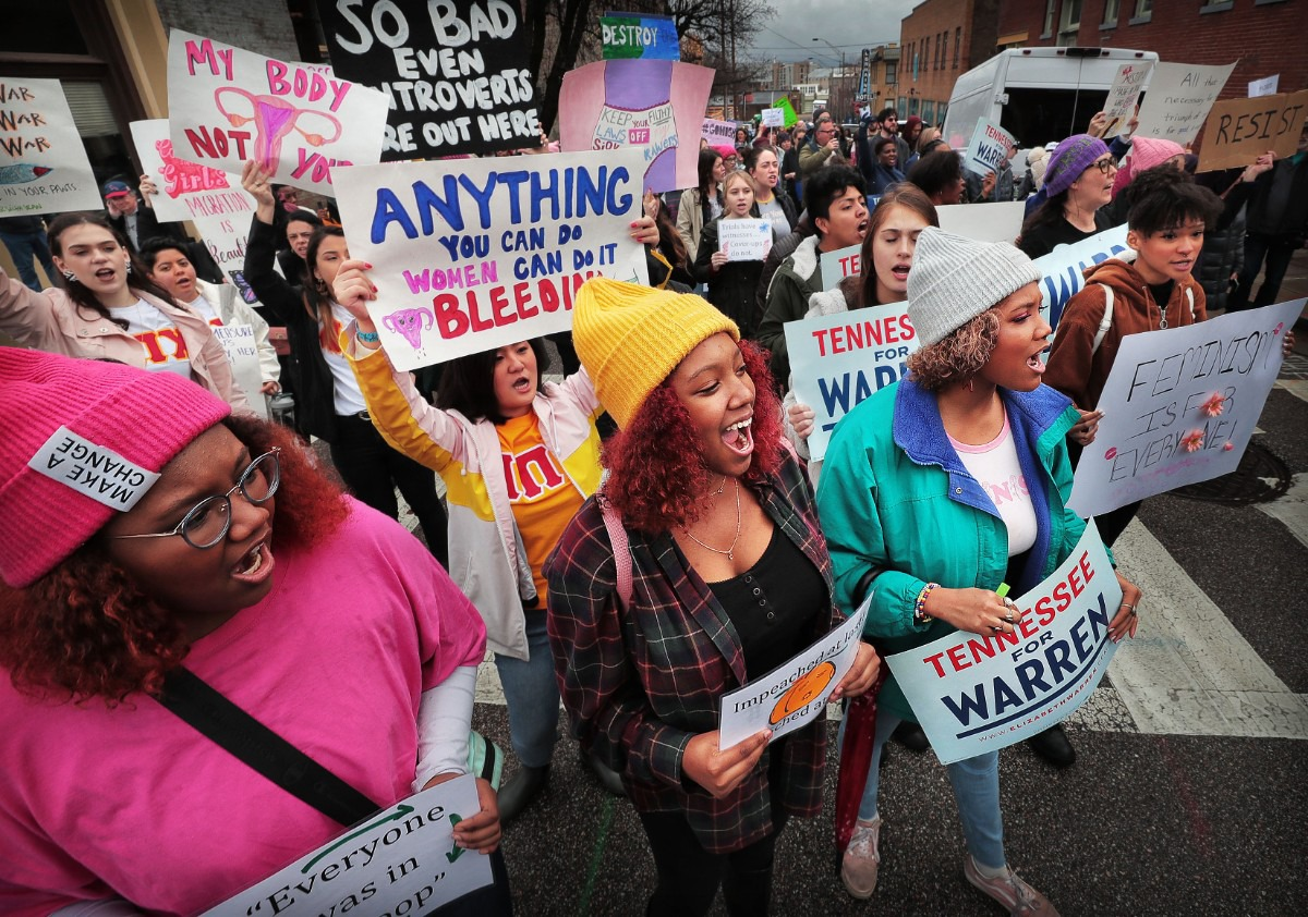 <strong>Sisters Jordan Serca (left), Sa'Maira Serca and Chloe Serca chant for unity during the Memphis Women's March Downtown on Jan. 18, 2020, as over 250 women's rights advocates gathered in the shadow of a looming election year to build awareness for equality, reproductive rights and discrimination issues.</strong> (Jim Weber/Daily Memphian)
