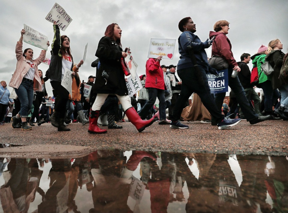 <strong>Marchers brave the rainy weather to attend the Memphis Women's March Downtown on Jan. 18, 2020, as over 250 women's rights advocates gathered in the shadow of a looming election year to build awareness for equality, reproductive rights and discrimination issues.</strong> (Jim Weber/Daily Memphian)