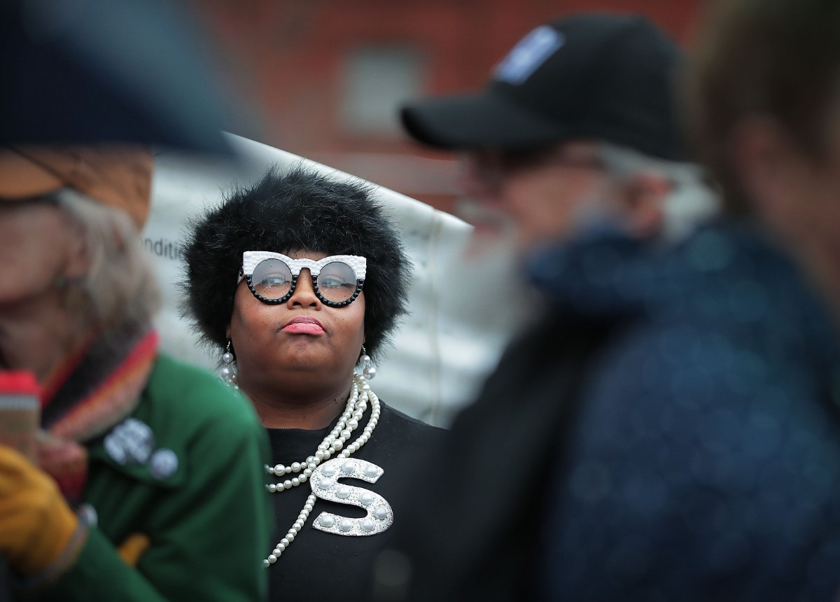 <strong>Shelica Cox waits in the rain at Clayborn Temple before the start of the Memphis Women's March Downtown on Jan. 18, 2020, as over 250 women's rights advocates gathered in the shadow of a looming election year to build awareness for equality, reproductive rights and discrimination issues.</strong> (Jim Weber/Daily Memphian)
