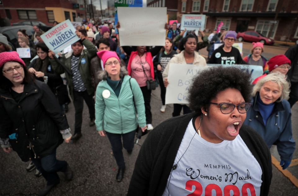 <strong>Event organizer Amber Sherman (right) leads chants for unity during the Memphis Women's March Downtown on Jan. 18, 2020, as over 250 women's rights advocates gathered in the shadow of a looming election year to build awareness for equality, reproductive rights and discrimination issues.</strong> (Jim Weber/Daily Memphian)