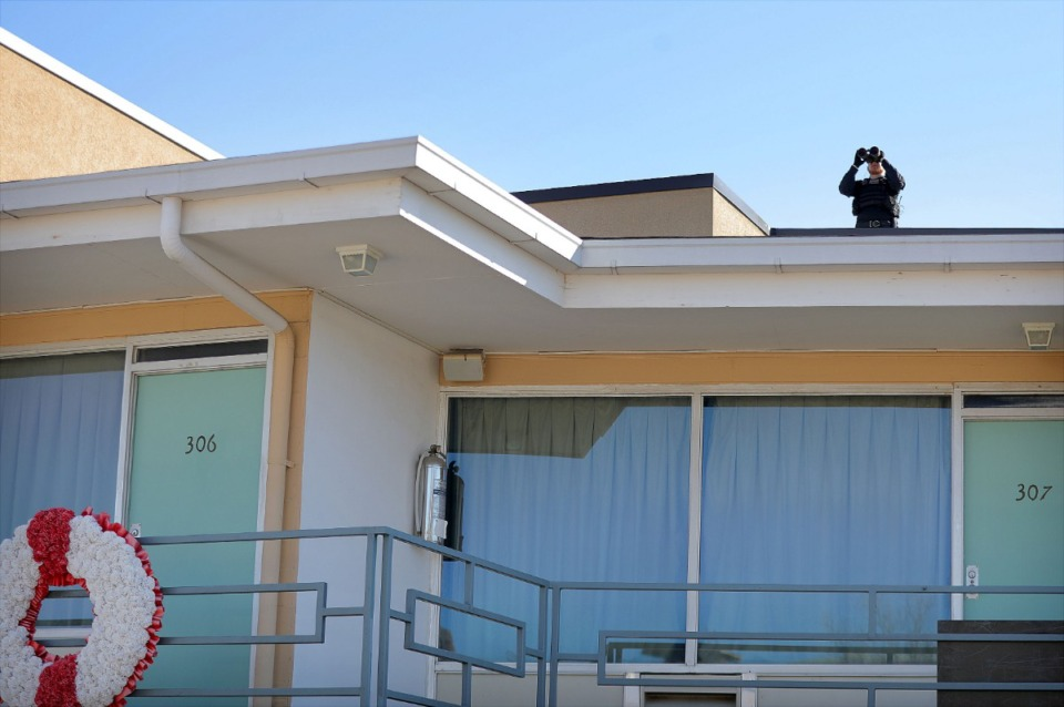 <strong>A Secret Service team member keeps watch above the motel room where Dr. Martin Luther King Jr. was slain.</strong> (Patrick Lantrip/Daily Memphian)