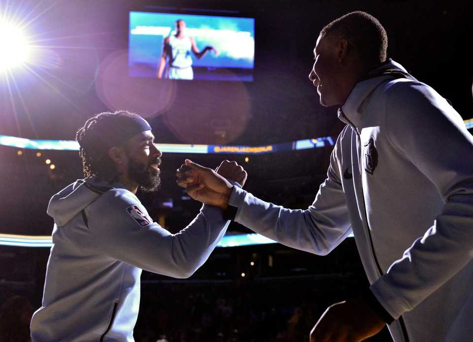 <strong>Memphis Grizzlies guard Mike Conley, left, and forward Jaren Jackson Jr. greet each other during player introductions before an NBA basketball game Wednesday, Nov. 7, 2018, in Memphis, Tenn.</strong> (AP Photo/Brandon Dill)
