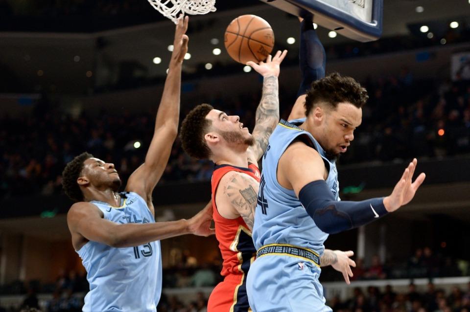 <strong>New Orleans Pelicans guard Lonzo Ball, center, shoots between Memphis Grizzlies guard Dillon Brooks, right, and forward Jaren Jackson Jr. (13) Jan. 20, 2020, iat FedExForum.</strong> (Brandon Dill/AP)