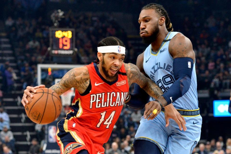 <strong>New Orleans Pelicans forward Brandon Ingram (14) drives against Memphis Grizzlies forward Jae Crowder (99) in the first half of an NBA basketball game Monday, Jan. 20, 2020, at FedExForum.</strong> (Brandon Dill/AP)