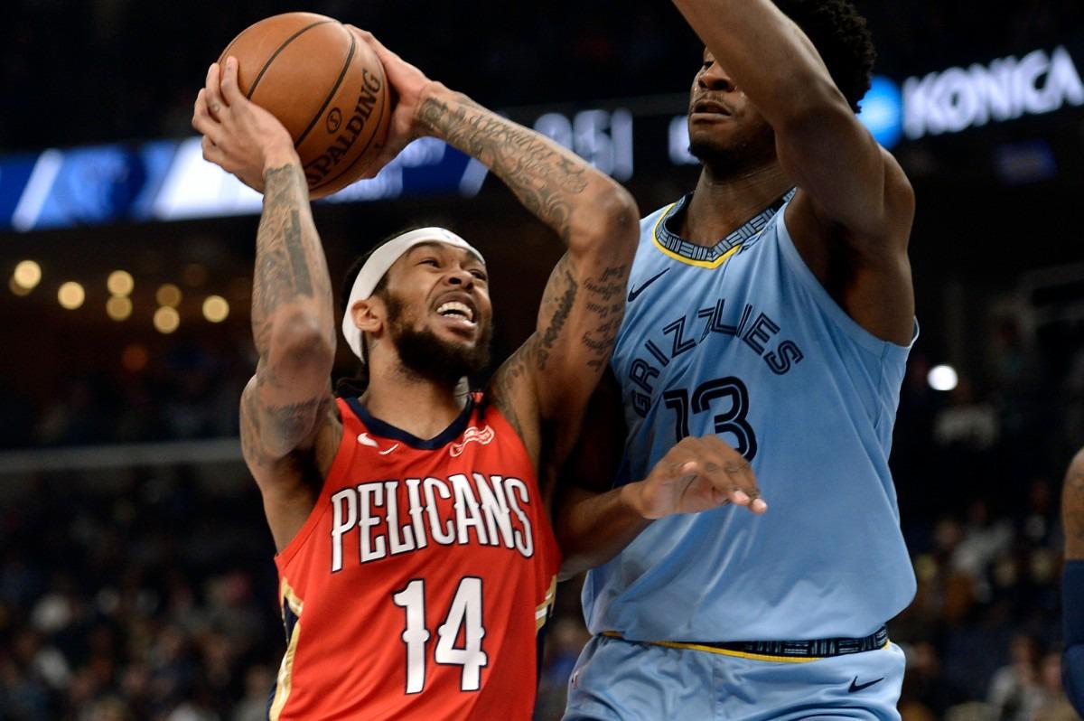 <strong>New Orleans Pelicans forward Brandon Ingram (14) drives against Memphis Grizzlies forward Jaren Jackson Jr. (13)&nbsp; Jan. 20, 2020, at FedExForum.</strong> (Brandon Dill/AP)