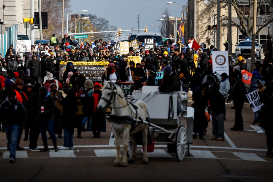 <strong>Hundreds make their way toward the National Civil Rights Museum during the 35th annual Dr. Martin Luther King Jr., Birthday Parade Monday, Jan. 20.</strong> (Mark Weber/Daily Memphian)
