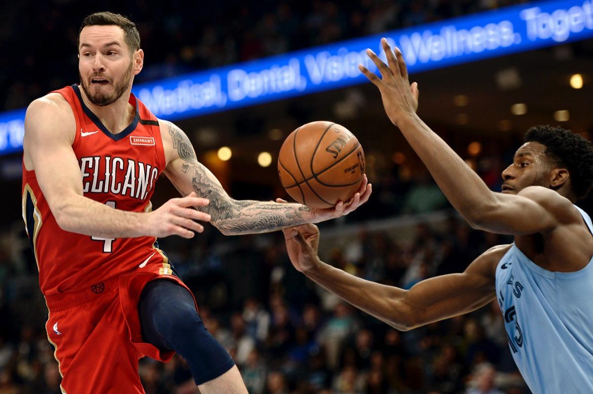 <strong>New Orleans Pelicans guard JJ Redick, left, drives ahead of Memphis Grizzlies forward Jaren Jackson Jr. (13) Jan. 20, 2020,&nbsp;at FedExForum.</strong> (Brandon Dill/AP)