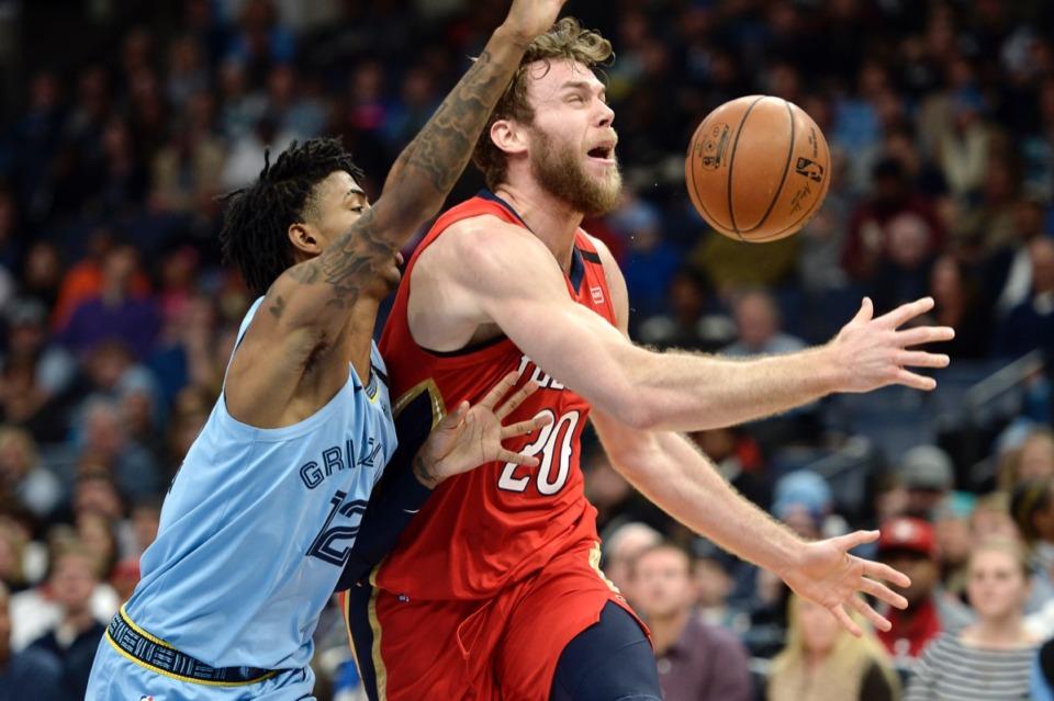 <strong>Memphis Grizzlies guard Ja Morant (12) knocks the ball away from New Orleans Pelicans forward Nicolo Melli (20)&nbsp;Jan. 20, 2020,&nbsp;at FedExForum.</strong> (Brandon Dill/AP)