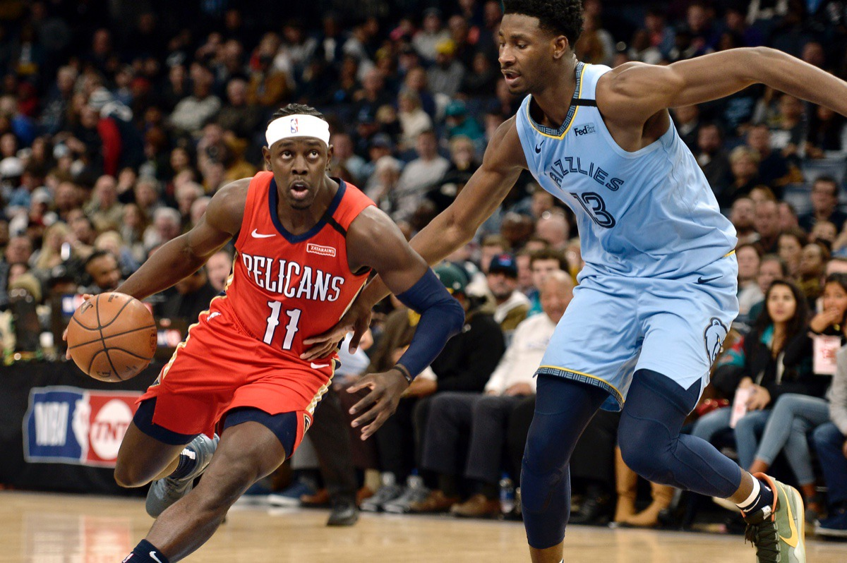<strong>New Orleans Pelicans guard Jrue Holiday (11) drives against Memphis Grizzlies forward Jaren Jackson Jr. (13)&nbsp;Jan. 20, 2020,&nbsp;at FedExForum.</strong> (Brandon Dill/AP)