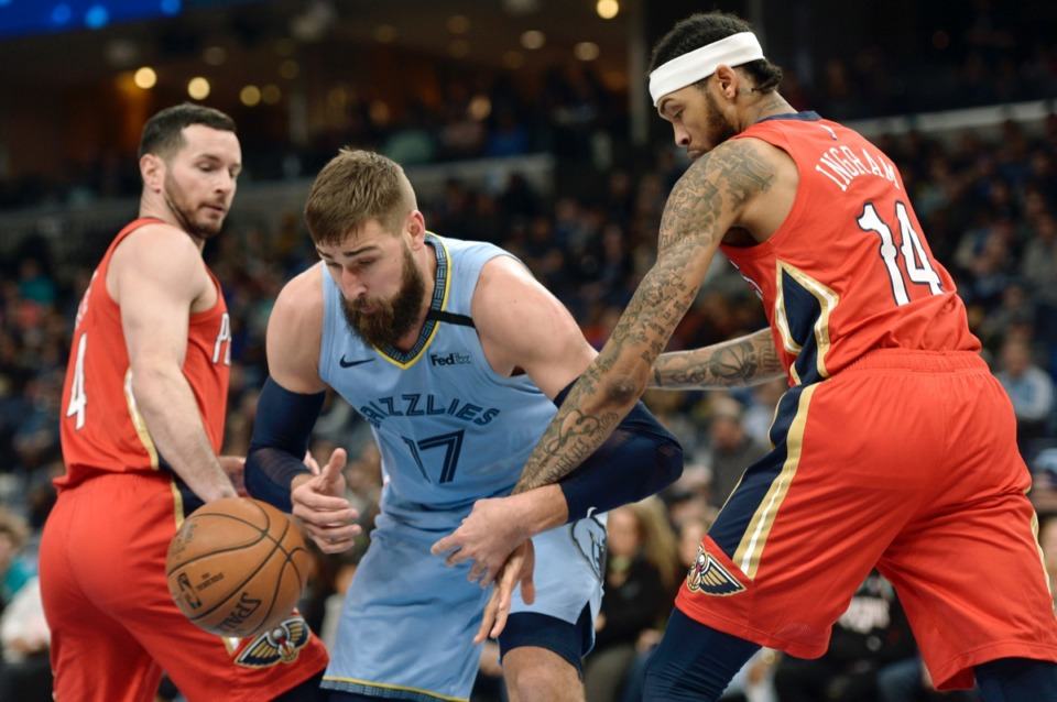 <strong>Memphis Grizzlies center Jonas Valanciunas (17) struggles for control of the ball with New Orleans Pelicans forward Brandon Ingram (14) Jan. 20, 2020, at FedExForum.</strong> (Brandon Dill/AP)