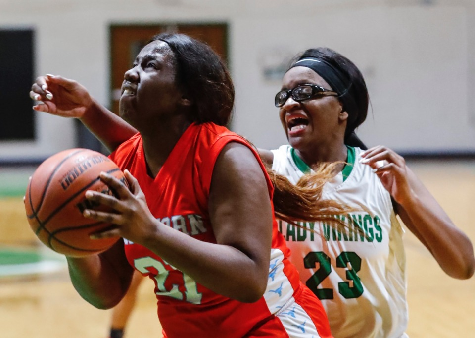 <strong>Westwood forward Tamyra Bland (left) makes a layup in front of Hillcrest defender Alexandra Wade (right) Jan. 21, 2020.</strong> (Mark Weber/Daily Memphian)