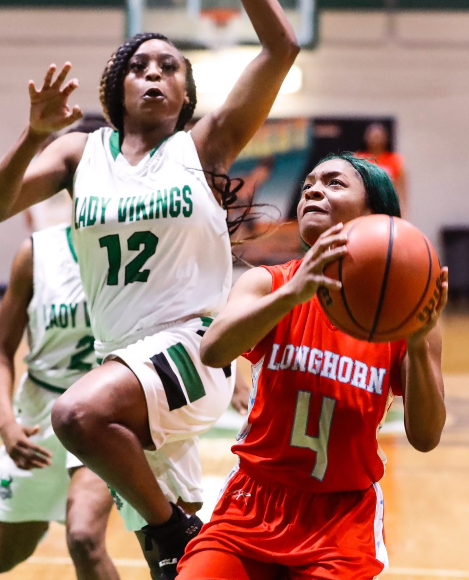 <strong>Westwood guard Cameesia Stewart (right) drives the lane against Hillcrest defender Kamaya Small (left) Jan. 21, 2020.</strong> (Mark Weber/Daily Memphian)