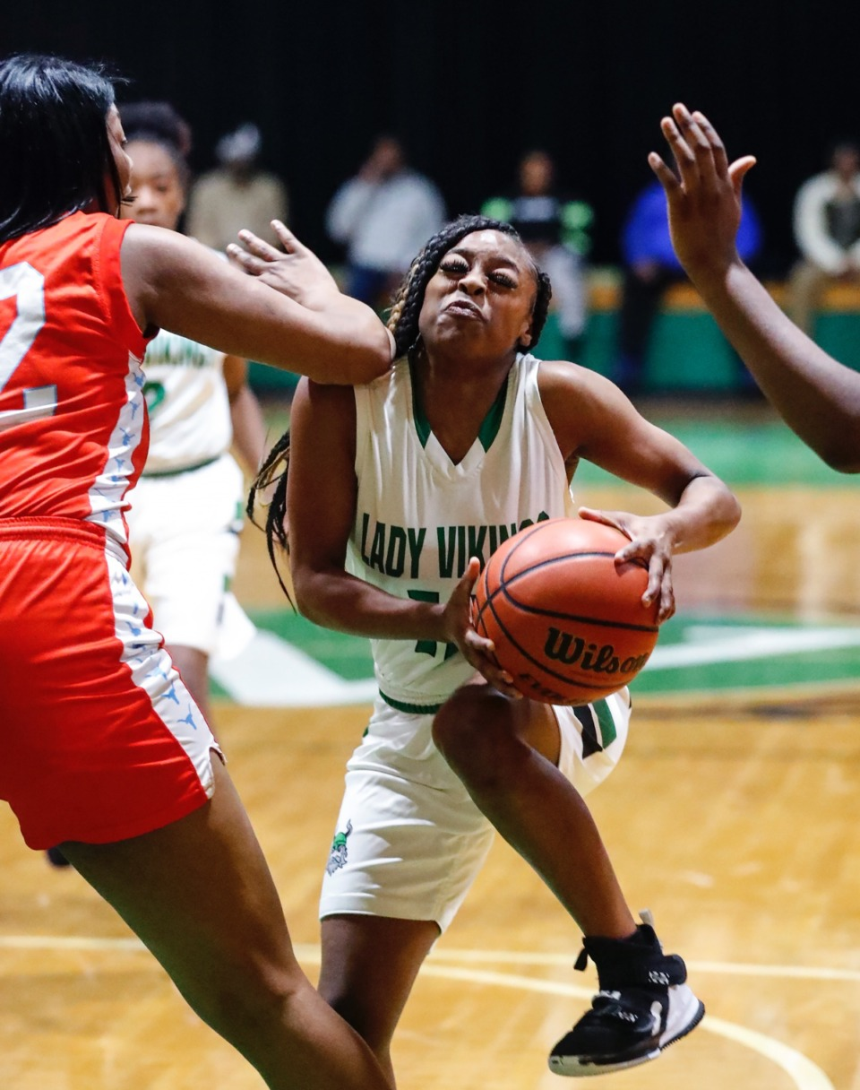 <strong>Hillcrest guard Kamaya Small (middle) drives to the basket against Westwood defense Jan. 21, 2020.</strong> (Mark Weber/Daily Memphian)