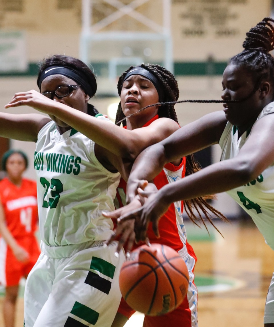 <strong>Westwood forward Takera Bland (middle) battles Hillcrest defenders Alexandra Wade (left) and Jaida Bachus (right) for a rebound Jan. 21, 2020.</strong> (Mark Weber/Daily Memphian)