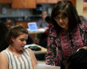 <strong>Bina Young, a middle school science teacher at St. George's Collierville campus, helps student Emma Reed during class March 26, 2019. </strong><span><strong>The school is among 30 Memphis-area private schools interested in participating in Tennessee's new education savings account program.</strong>&nbsp;</span>(Patrick Lantrip/Daily Memphian file)
