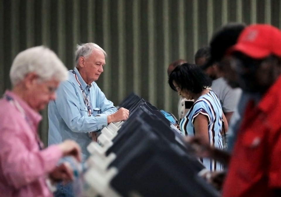 <strong>Thomas Rodgers (second from left) assists a throng of early voters at Whitehaven's Abundant Grace Fellowship Church Sept. 20, 2019.</strong> (Patrick Lantrip/Daily Memphian)