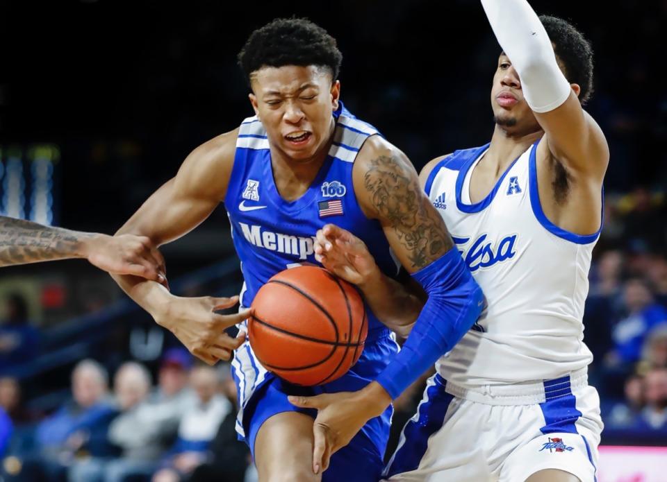 <strong>Memphis guard Boogie Ellis (left) drives the lane against Tulsa defender Isaiah Hill (right) Wednesday, Jan. 22, 2020, in Tulsa, Oklahoma.</strong> (Mark Weber/Daily Memphian)